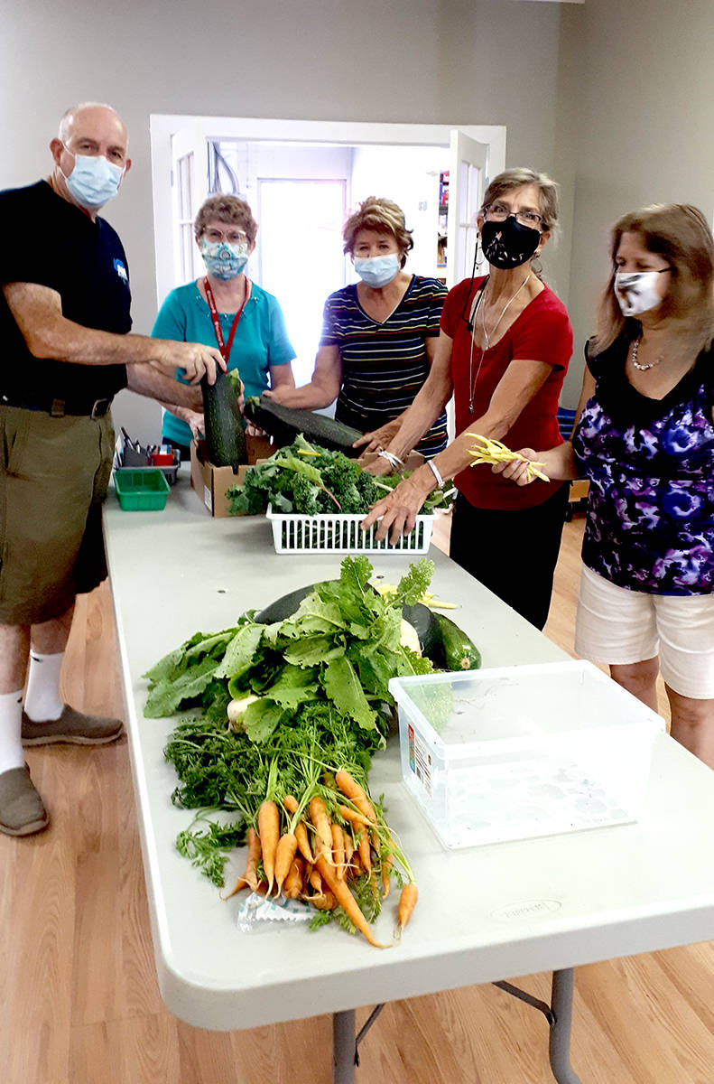 Mark, Mary, Elizabeth, Tannis Tina, volunteers at the Aldergrove Food Bank working amid what they like to call zucchini day. (Special to The Star)