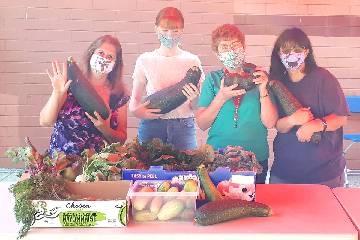 Tina, Sarah, Mary and Patsy show off the veggies donated to Aldergrove Food Bank. (Special to The Star)