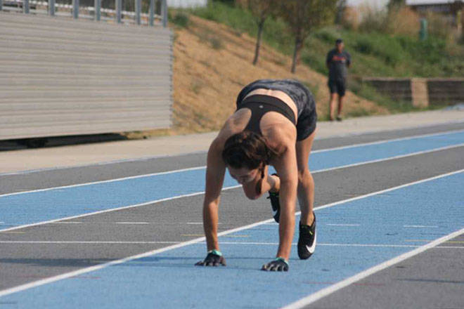 Vernon summer resident Julie McCann (née Holland) set an unofficial world record Monday, Aug. 9, at Greater Vernon Athletic Park, becoming the fastest woman to run 100 metres on all fours with a clocking of 22.99 seconds. (Christine Castrucow photo)