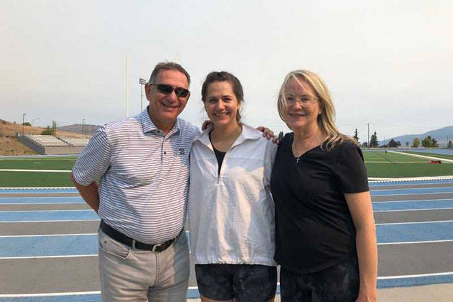 Vernon resident Julie McCann (centre) is flanked by proud parents Ken and Cindy Holland after setting an unofficial world record Monday, Aug. 9, at Greater Vernon Athletic Park for being the fastest woman to cover 100 metres on all fours (22.99 seconds). (Diane Bowers photo)