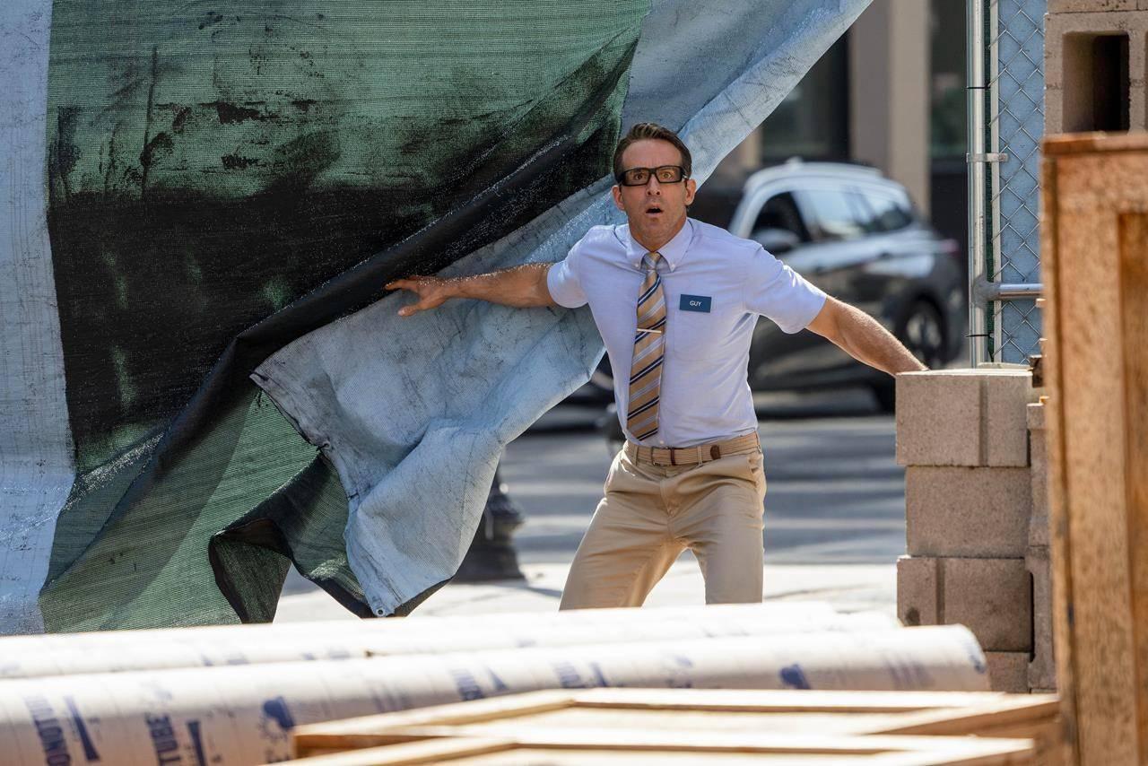 "Ryan Reynolds is shown as Guy in 20th Century Studios' ""Free Guy"" in this undated handout photo. THE CANADIAN PRESS/2020 Twentieth Century Fox Film Corporation, Alan Markfield"