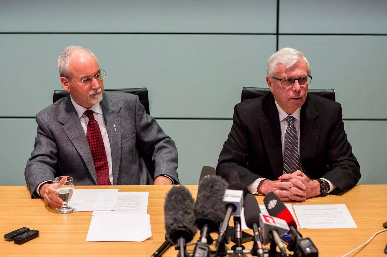 Sergeant-at-Arms Gary Lenz, left, and Clerk of the Legislative Assembly Craig James make a statement to media in Vancouver, B.C., Monday, Nov. 26, 2018. British Columbia's Prosecution Service says no further charges will be recommended following an RCMP investigation into spending activities of senior staff at the legislature. THE CANADIAN PRESS/Ben Nelms