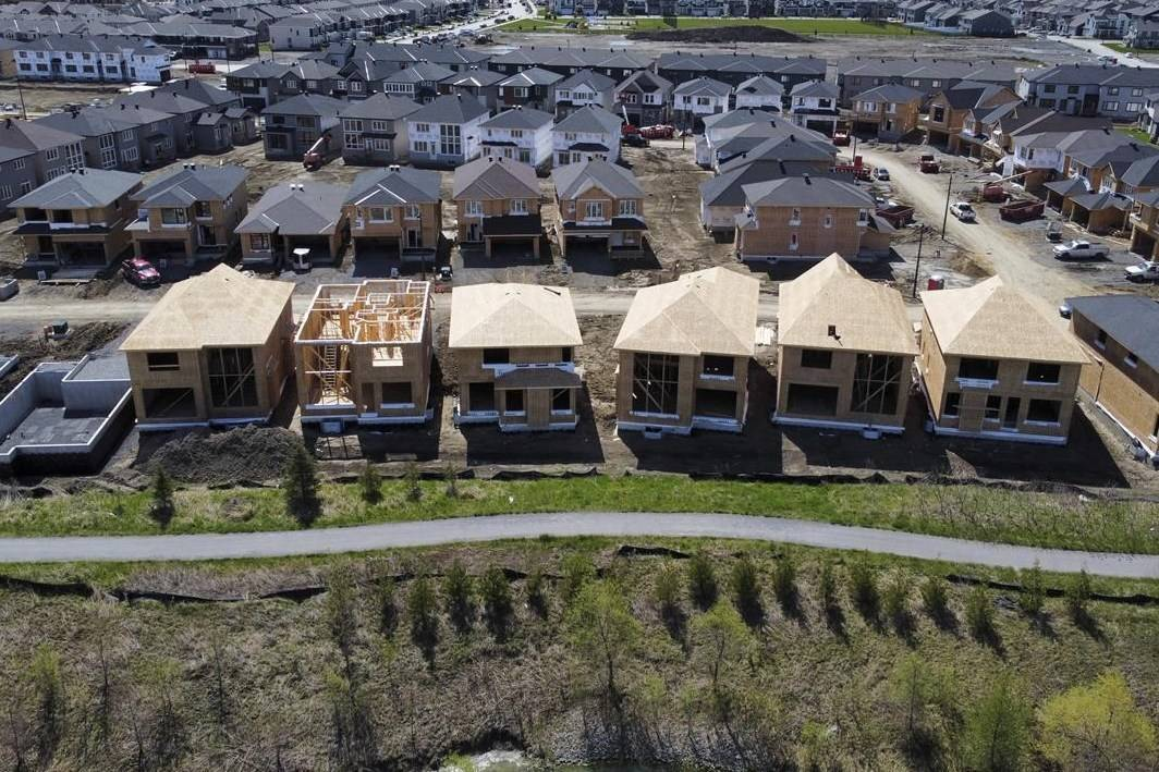 New homes are built in a housing construction development in the west end of Ottawa on Thursday, May 6, 2021. Parliament's budget watchdog says the government is falling short of its aim of vastly expanding Canada's affordable housing stock despite a spending ramp-up in the hundreds of millions of dollars. THE CANADIAN PRESS/Sean Kilpatrick