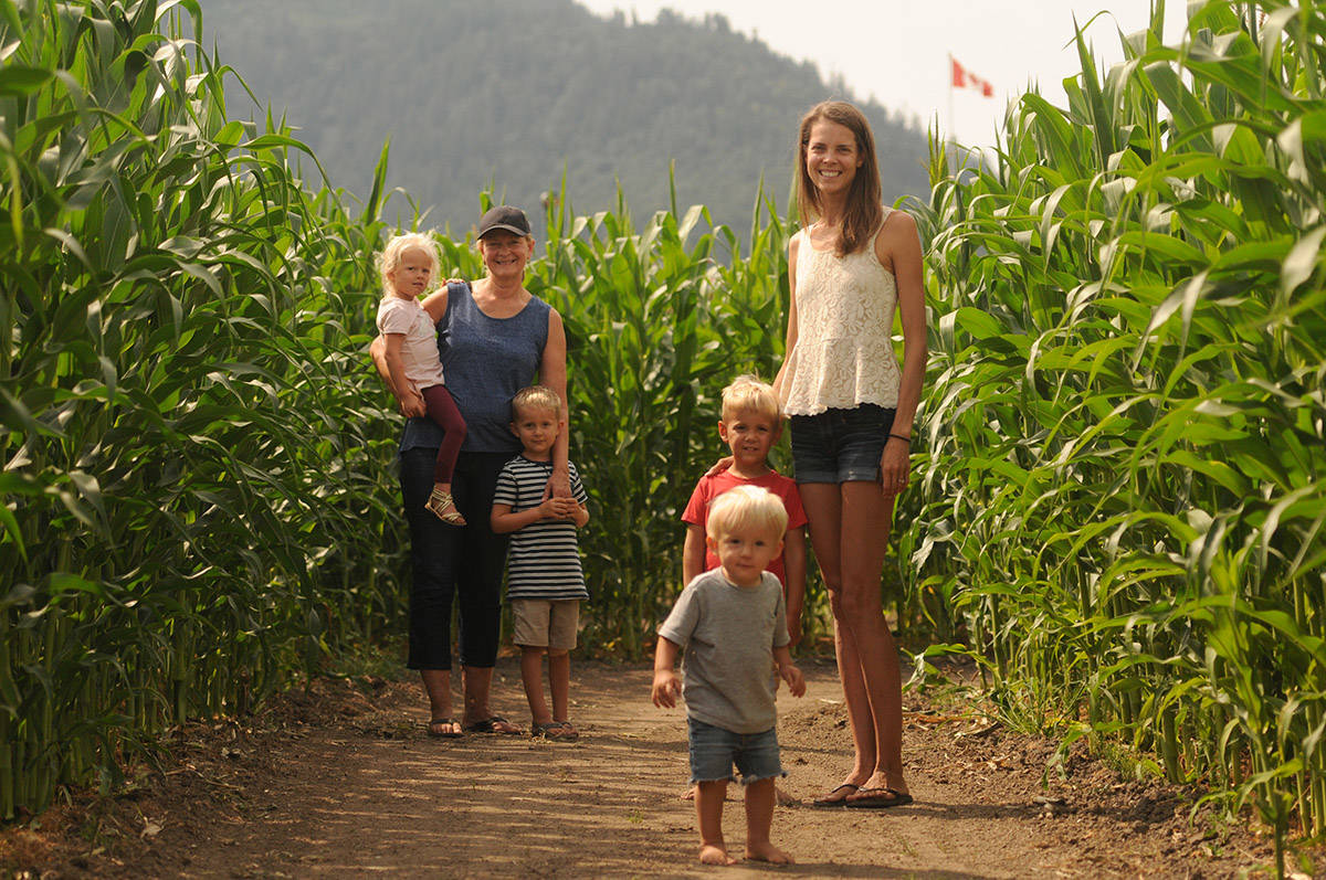 Vanessa Oddy (right) and her mom Diane Bruinsma are seen here on Aug. 11, 2020 with Oddy's two children Aiden (grey shirt) and John (red shirt) and her niece Fay and nephew Nash (at back). Oddy, along with her two sisters who own the Chilliwack Corn Maze, is getting ready to open their attraction on Aug. 14. (Jenna Hauck/ Chilliwack Progress file)