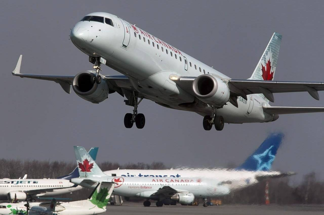 An Air Canada jet takes off from Halifax Stanfield International Airport in Enfield, N.S. on Thursday, March 8, 2012. THE CANADIAN PRESS/Andrew Vaughan