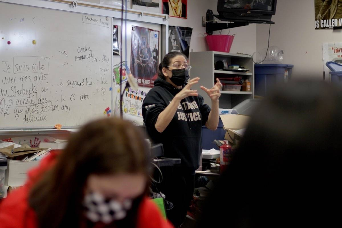 Annie Ohana, a teacher at L.A. Matheson Secondary, teaches a Grade 8 class on Friday, March 12, 2021. Ohana is one of many teachers calling for another mask mandate in schools before the 2021-22 school year starts. (Photo: Lauren Collins)