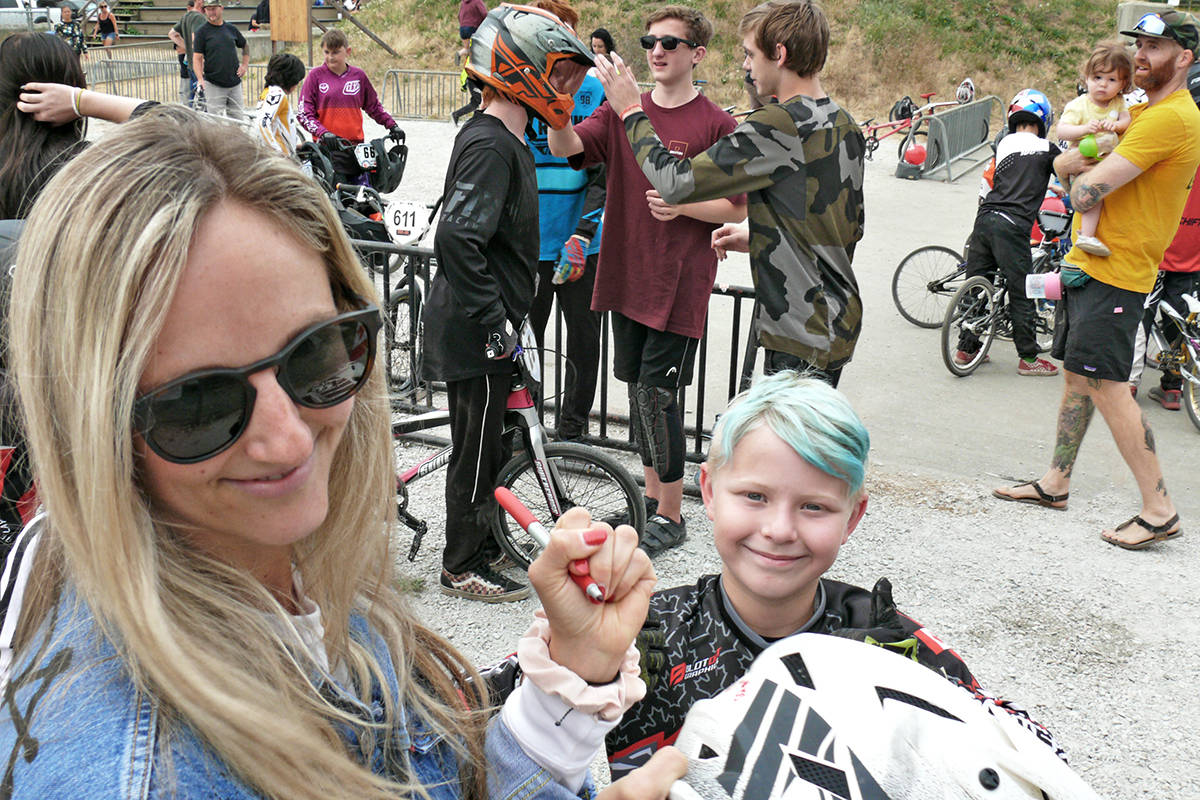 Drew Mechielsen, seen here signing autographs at the Langley BMX track at a welcome home event on her return from the Olympics on Sunday, Aug. 1, discovered three days later that she'd been competing with a broken foot. (Dan Ferguson/Langley Advance Times)
