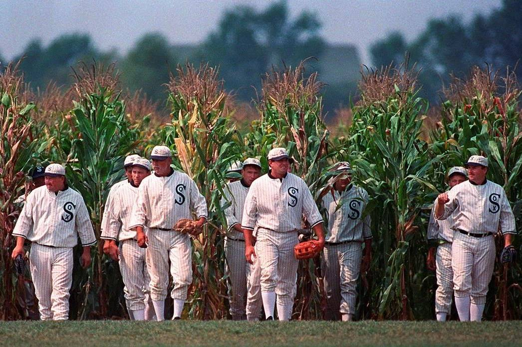 """FILE - Persons portraying ghost player characters, similar to those in the film """"Field of Dreams,"""" emerge from the cornfield at the """"Field of Dreams"""" movie site in Dyersville, Iowa, in this undated file photo. Three decades after Kevin Costner's character built a ballpark in a cornfield in the movie """"Field of Dreams,"""" the iconic site in Dyersville, Iowa, prepares to host the state's first Major League Baseball game at a built-for-the-moment stadium for the Chicago White Sox and New York Yankees. (AP Photo/Charlie Neibergall, File)"""