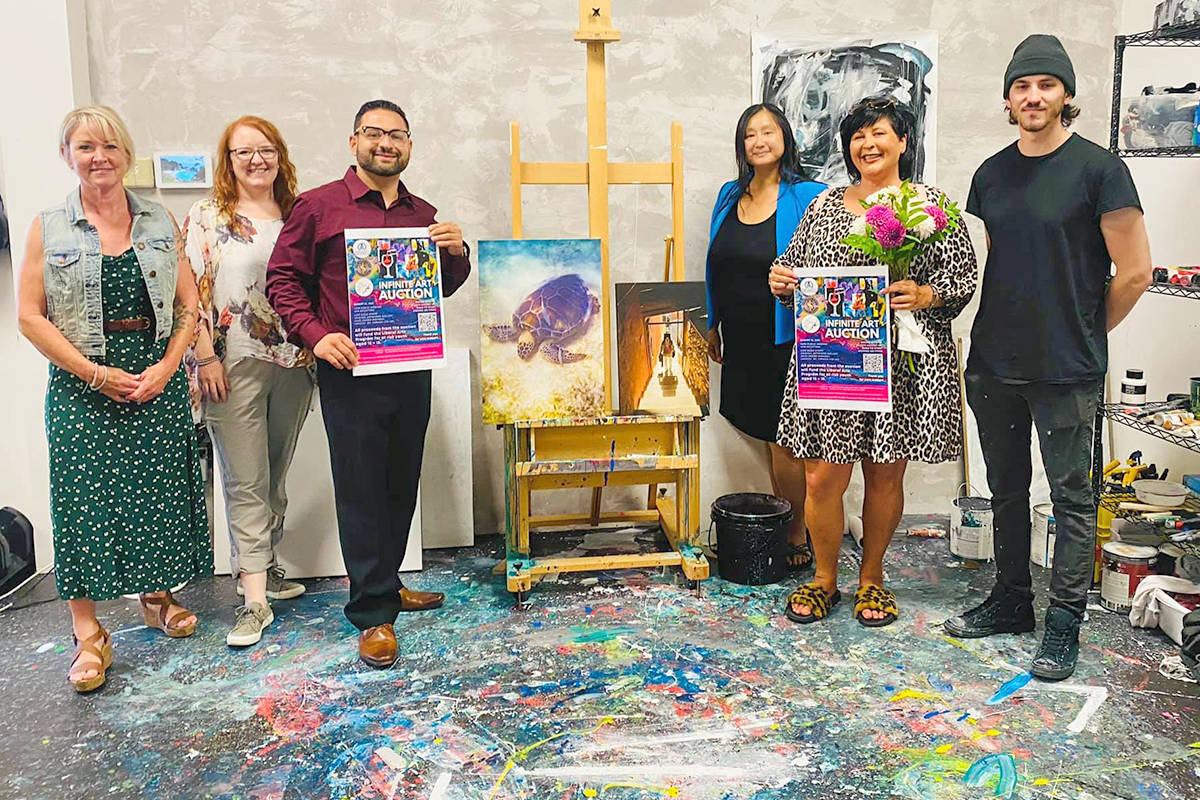 The inaugural art auction by the Infinite Expansion Foundation has the support of several local artists and community members, including Langley City Mayor Van van den Broek (second from right), who recently met with the founation board. (Infinite Expansion Foundation)