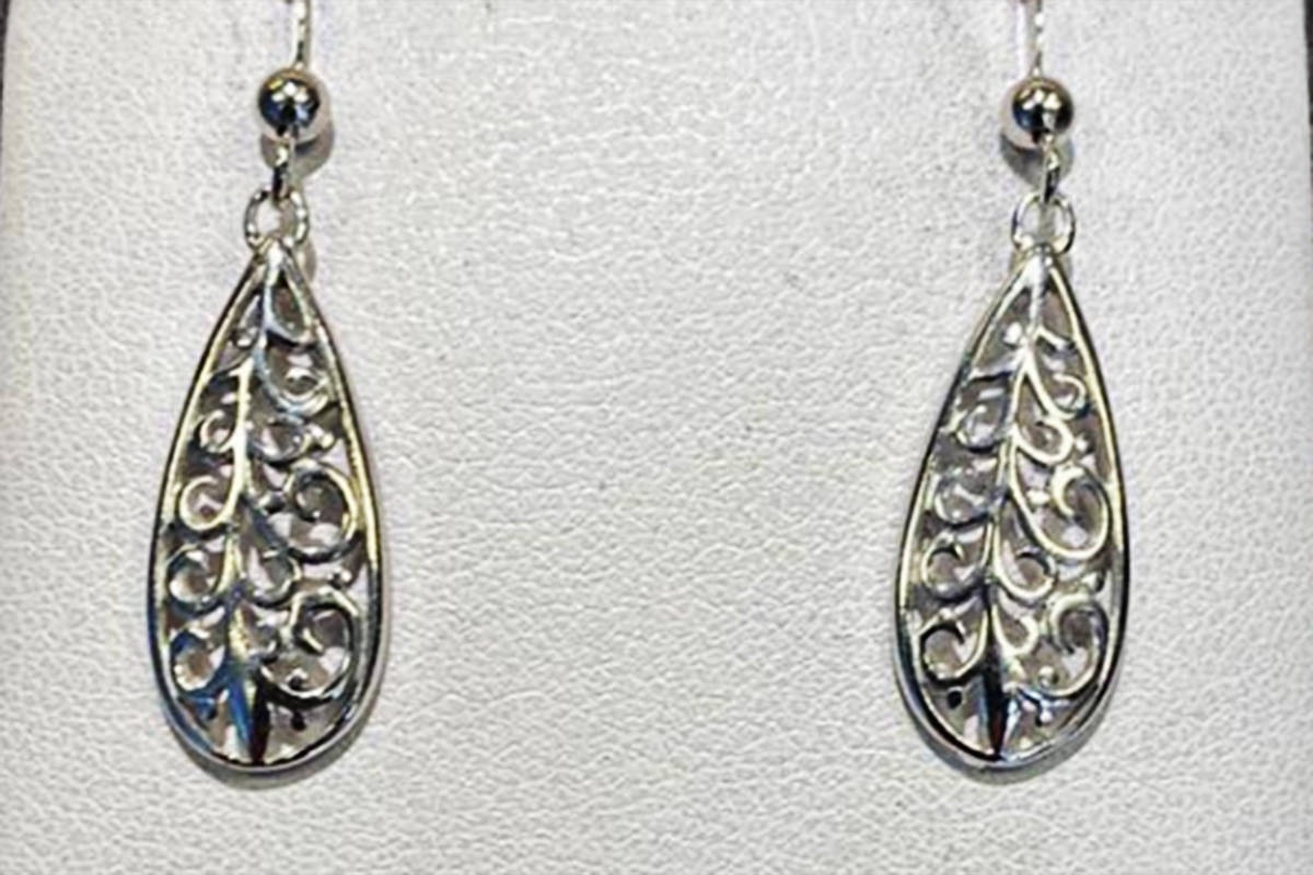 The auction includes paintings and other art as well as these sterling silver earrings. (Infinite Expansion Foundation auction)