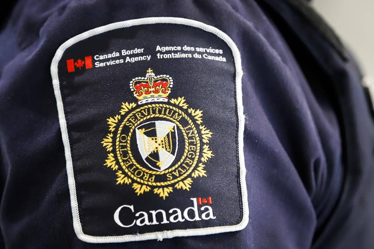 A Canada Border Services Agency (CBSA) patch is seen on an officer in Calgary, Alberta. (THE CANADIAN PRESS/Jeff McIntosh)