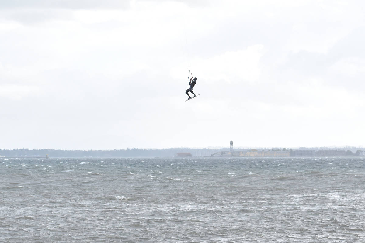 More than a dozen kiteboarders took advantage of high wind last winter. Surfers soared up in the air and performed tricks for spectators watching from the White Rock Pier. (Aaron Hinks photos)