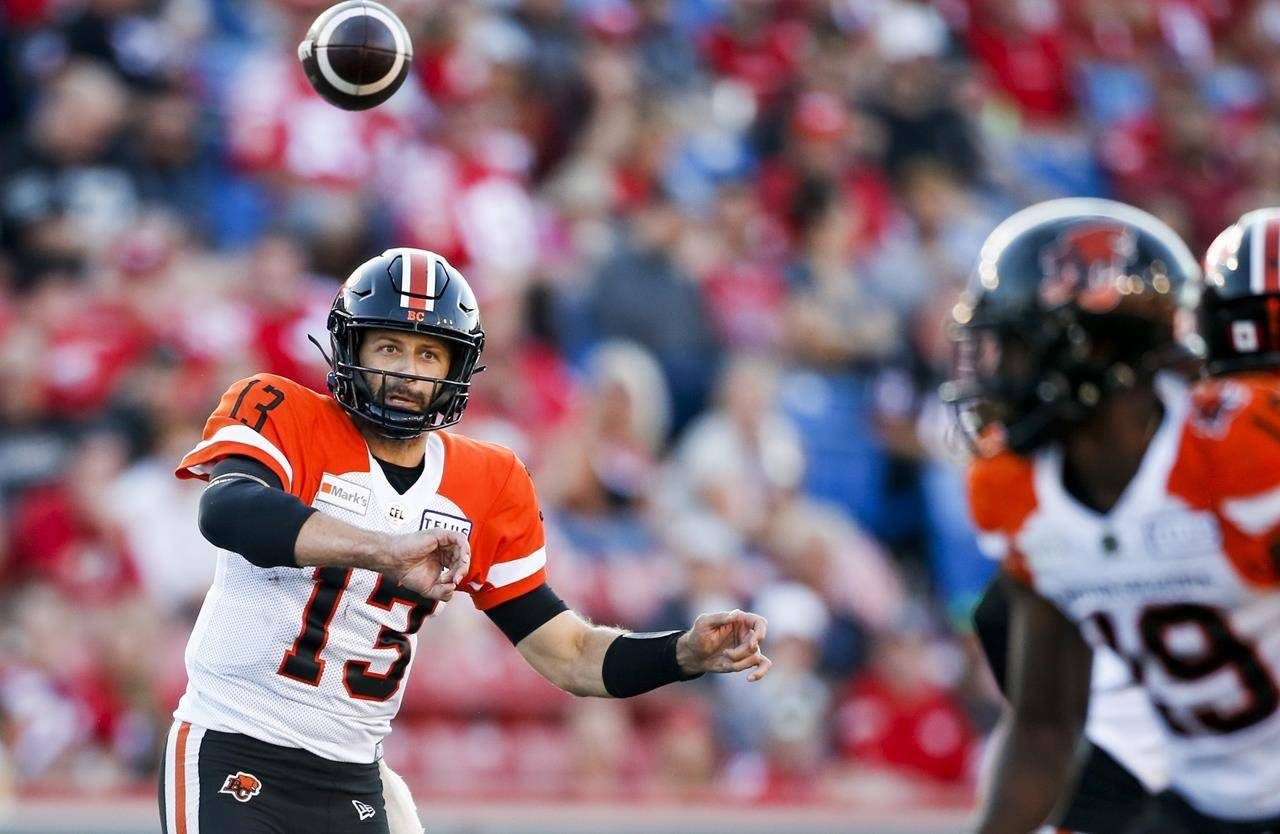 BC Lions quarterback Michael Reilly throws the ball during first-half CFL football action against the Calgary Stampeders in Calgary, Thursday, Aug. 12, 2021.THE CANADIAN PRESS/Jeff McIntosh