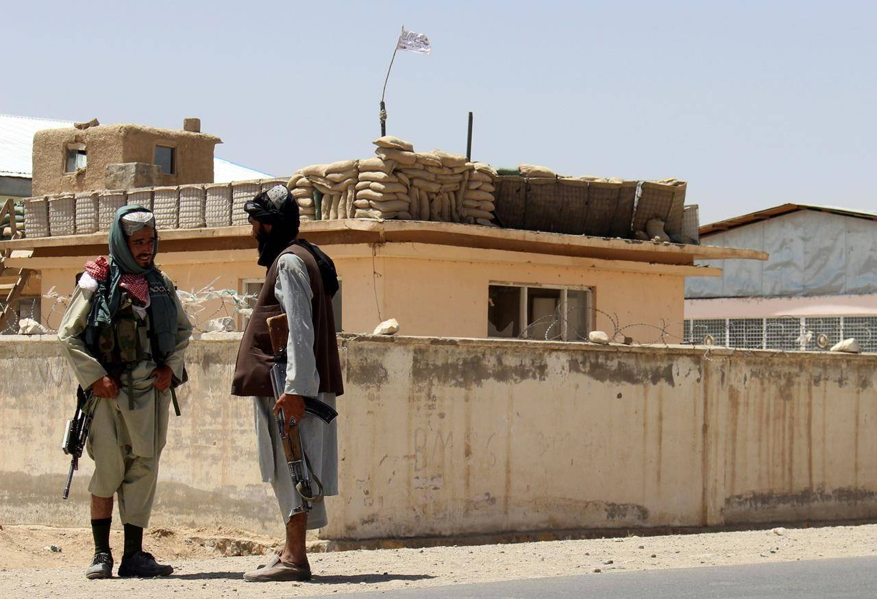 Taliban fighters stand guard inside the city of Ghazni, southwest of Kabul, Afghanistan, Friday, Aug. 13, 2021. The Canadian government is facing urgent calls to speed up its effort to save hundreds of former Afghan interpreters and their families as Western countries step up plans to evacuate Afghanistan after 20 years of war. THE CANADIAN PRESS/AP/Gulabuddin Amiri