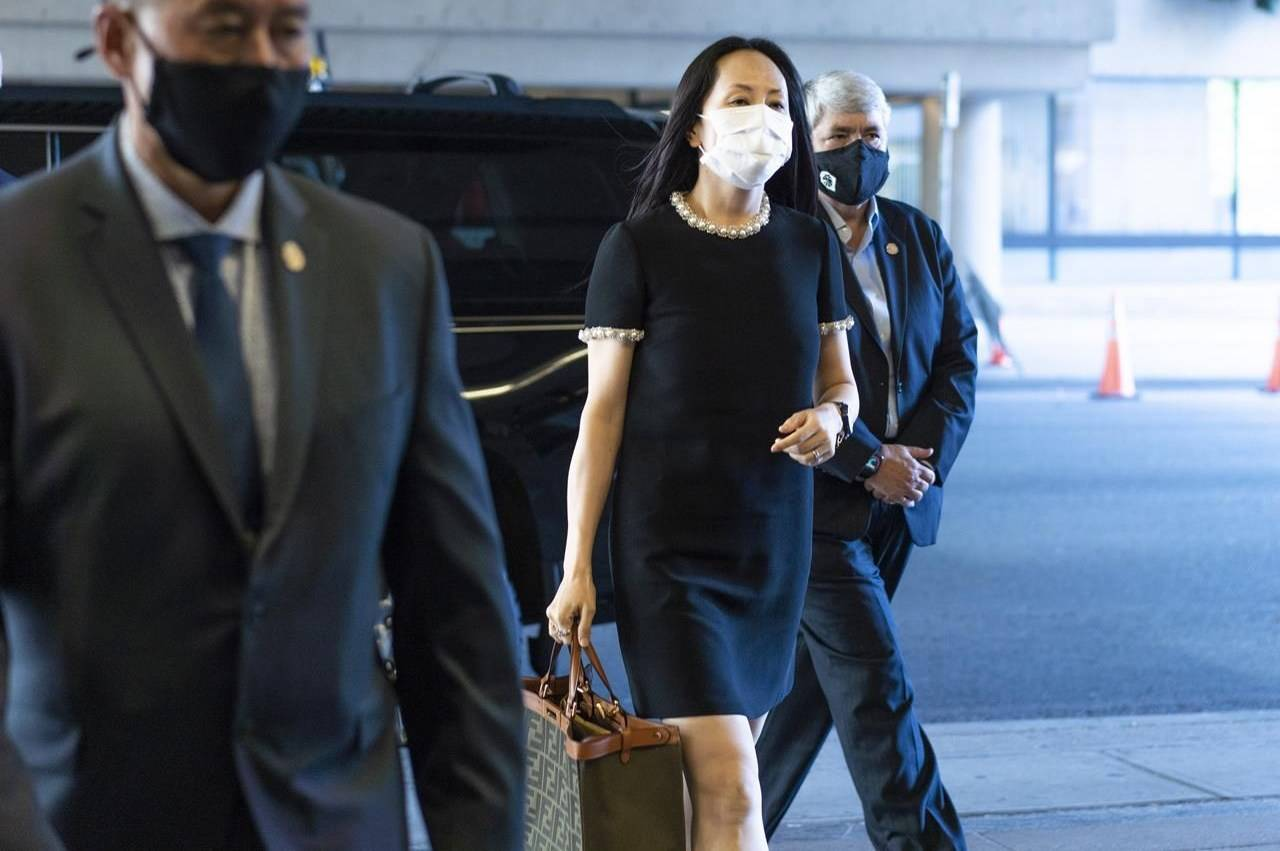 Meng Wanzhou, chief financial officer of Huawei, arrives at her extradition hearing at B.C. Supreme Court, in Vancouver, British Columbia, Thursday, August 12, 2021. THE CANADIAN PRESS/Jimmy Jeong
