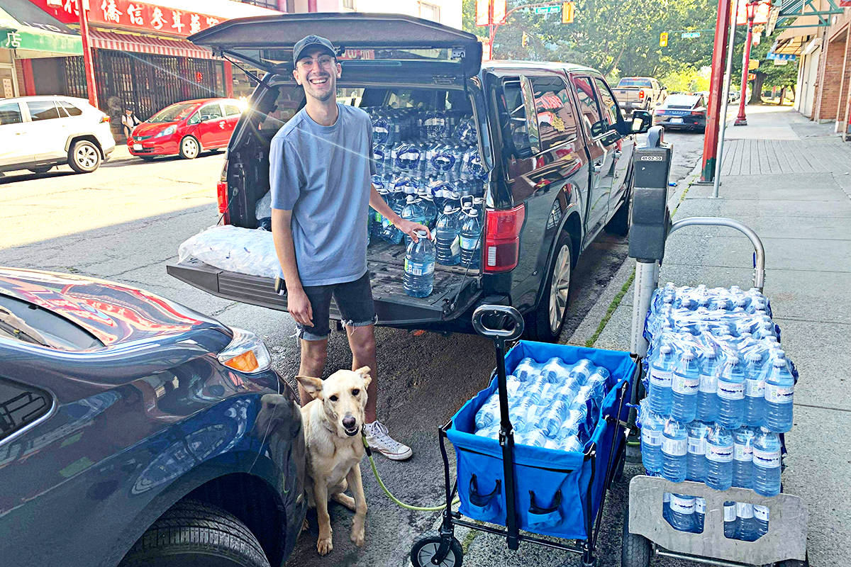 Aaron Bailey is among those who helped distribute water and other goods to disadvantaged people. (Seraphina Skands/Special to the Langley Advance Times)