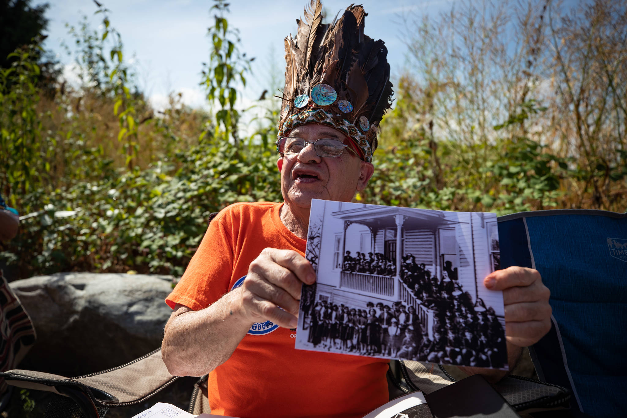 Willie Nahanee, 79, of the Squamish Nation, who attended the former St. Paul Indian Residential School for 10 years and the Kamloops Indian Residential School for one year, holds one of his class photographs from St. Paul, in North Vancouver, on Tuesday, August 10, 2021. The Squamish Nation, together with the support of the Tsleil-Waututh and Musqueam First Nations and the Catholic Archdiocese will be launching an investigation into the former residential school. (THE CANADIAN PRESS/Darryl Dyck)
