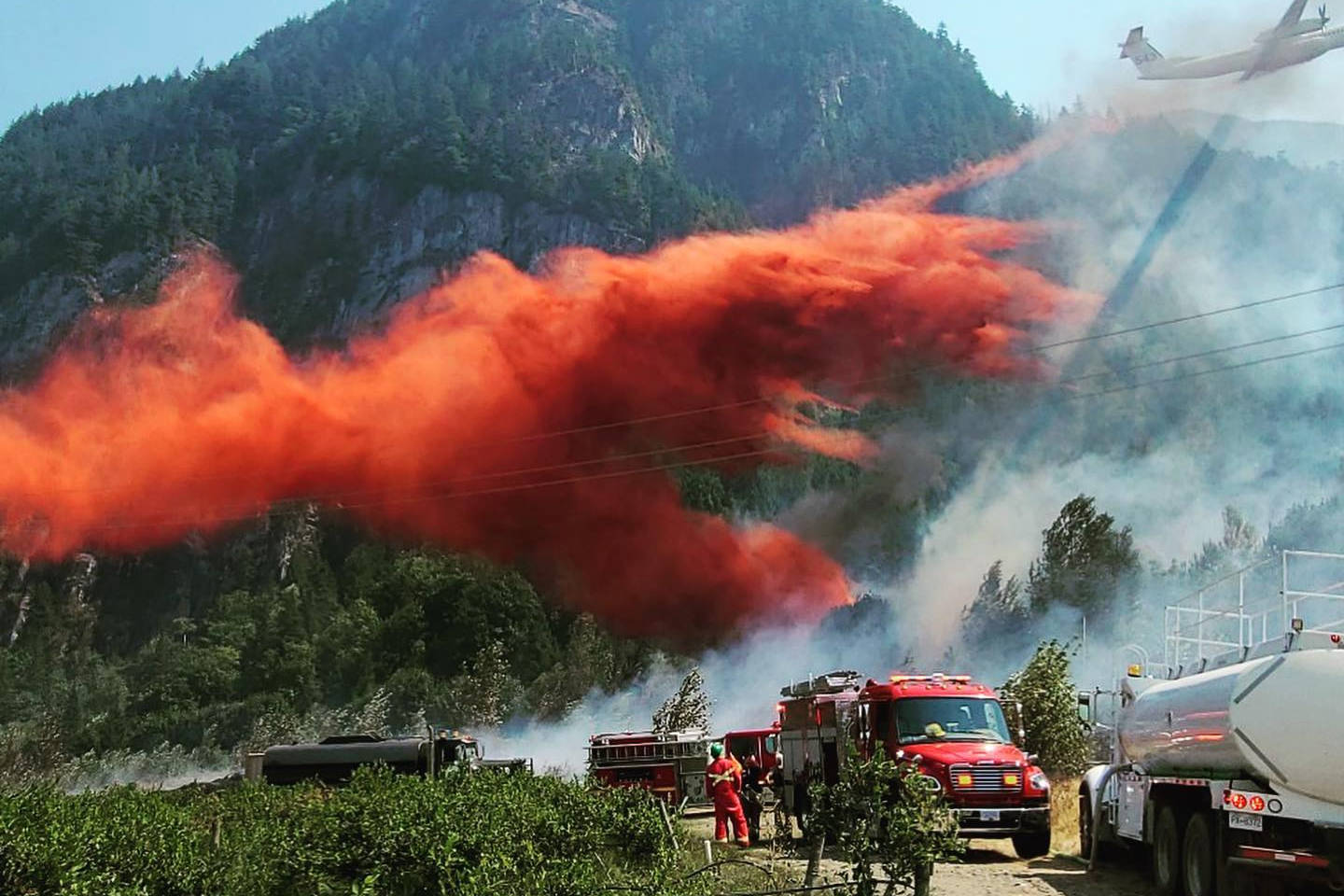 B.C. Wildfire Service dropped fire retardant on a wildland fire in Laidlaw on Aug. 12, 2021. (Hope Fire Department/ Submitted)