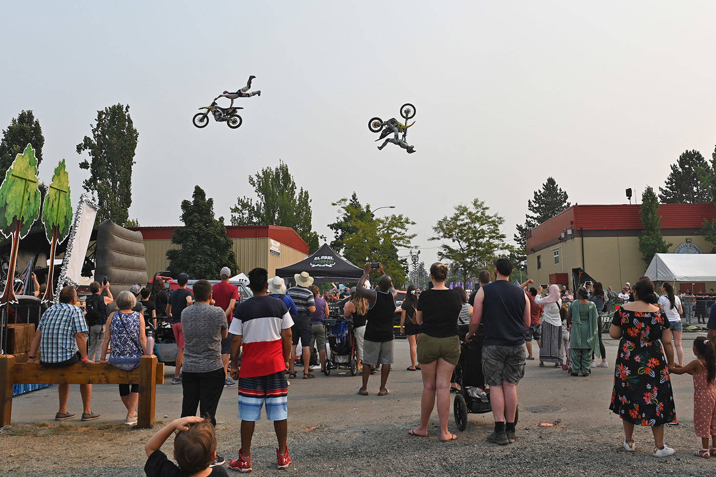 Motocross riders with Global FMX from Kelowna, B.C. do mid-air stunts during the Abbotsford Agrifair on Sunday, Aug. 1, 2021. (Jenna Hauck/ Black Press)