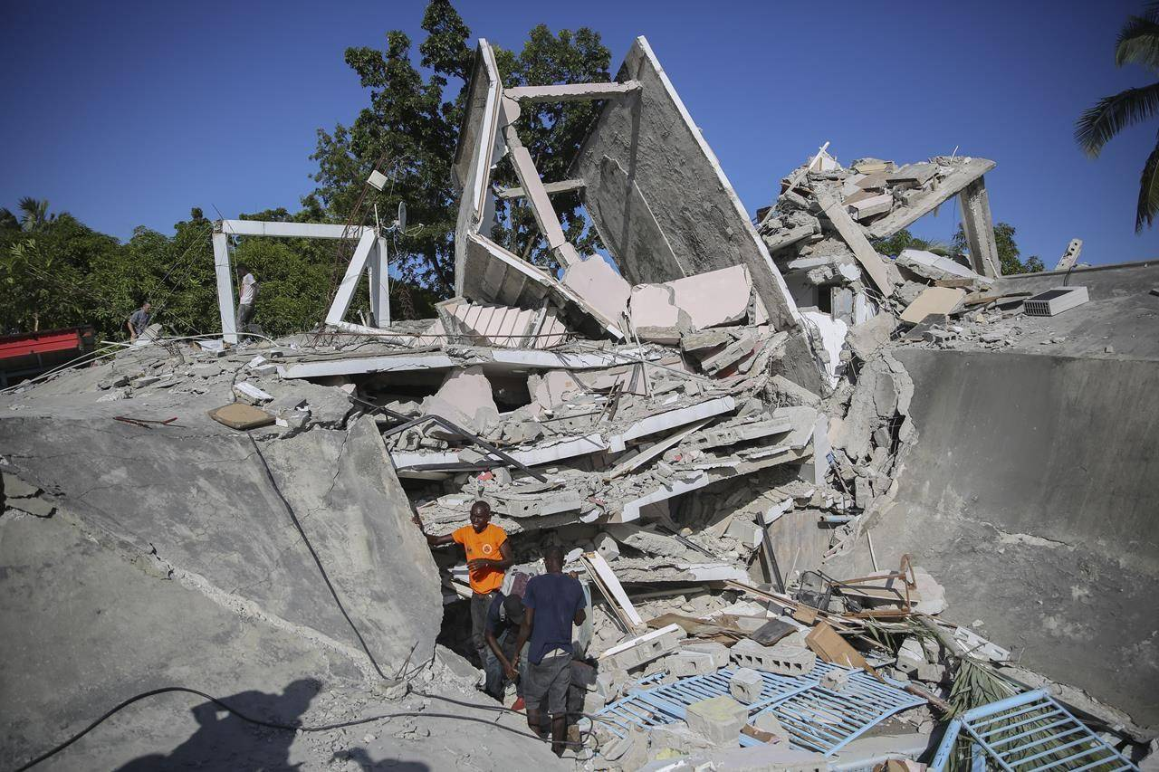 The residence of the Catholic bishop lays in ruins after an earthquake in Les Cayes, Haiti, Saturday, Aug. 14, 2021. A 7.2 magnitude earthquake struck Haiti on Saturday, with the epicenter about 125 kilometers (78 miles) west of the capital of Port-au-Prince, the US Geological Survey said. (AP Photo/Joseph Odelyn)