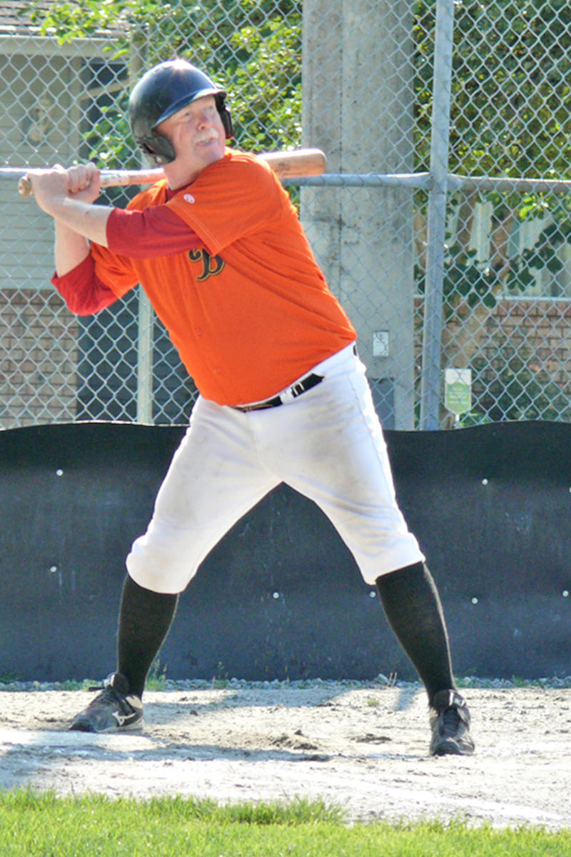 Buzzard Merv Sandrel waits for the pitch. A new league for baseball players 60 and older launched at Langley's City Park on Sunday, Aug. 15. It is believed to be the first of its kind in the Lower Mainland.(Dan Ferguson/Langley Advance Times)