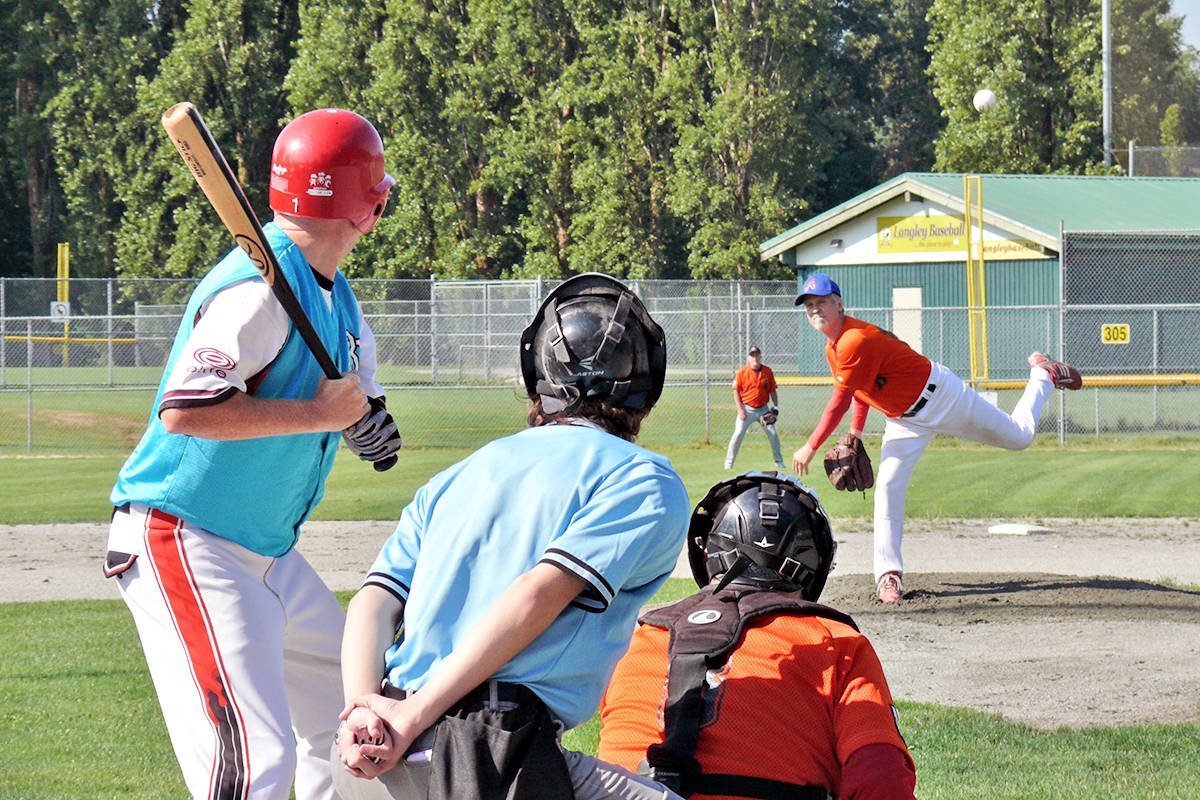 Caps Keeley Warren is at bat as Buzzard pitcher Bruce Taylor fires one in. A new league for baseball players 60 and older launched at Langley's City Park on Sunday, Aug. 15. It is believed to be the first of its kind in the Lower Mainland.(Dan Ferguson/Langley Advance Times)