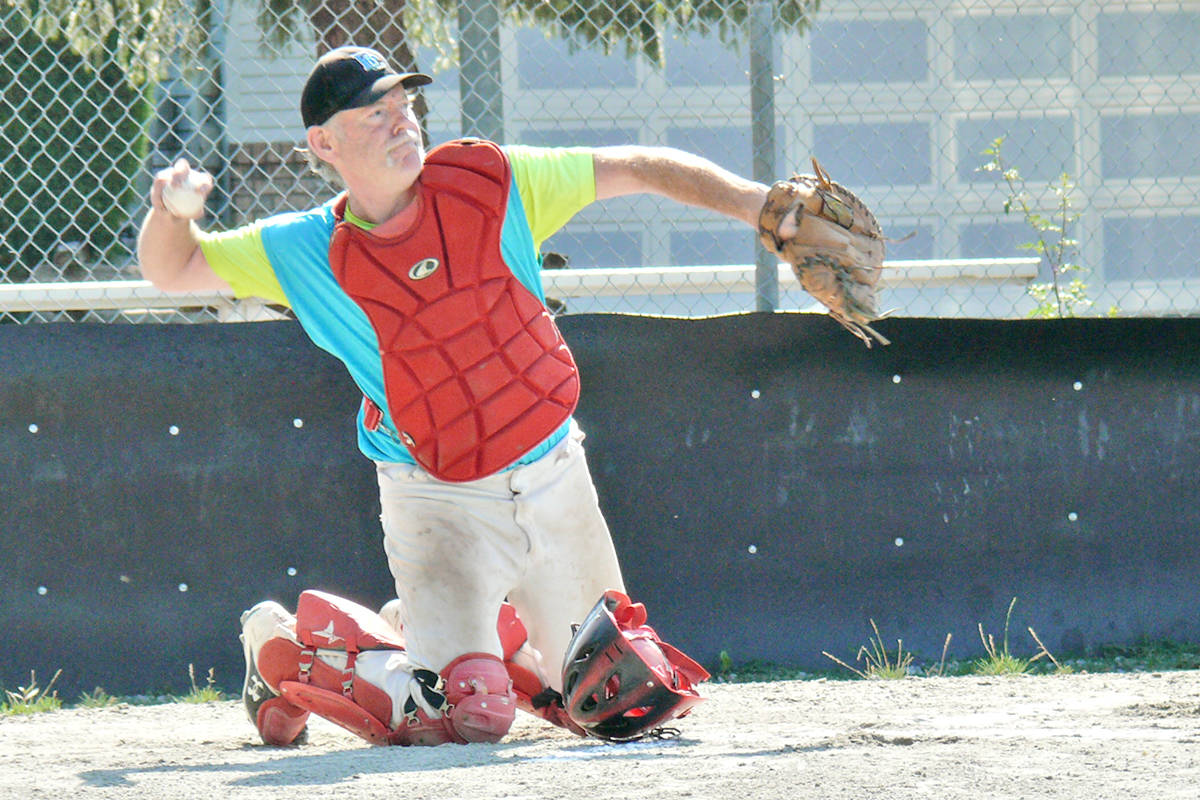 Catcher Howard Sandrel helped organize a new league for baseball players 60 and older launched at Langley's City Park on Sunday, Aug. 15. It is believed to be the first of its kind in the Lower Mainland.(Dan Ferguson/Langley Advance Times)