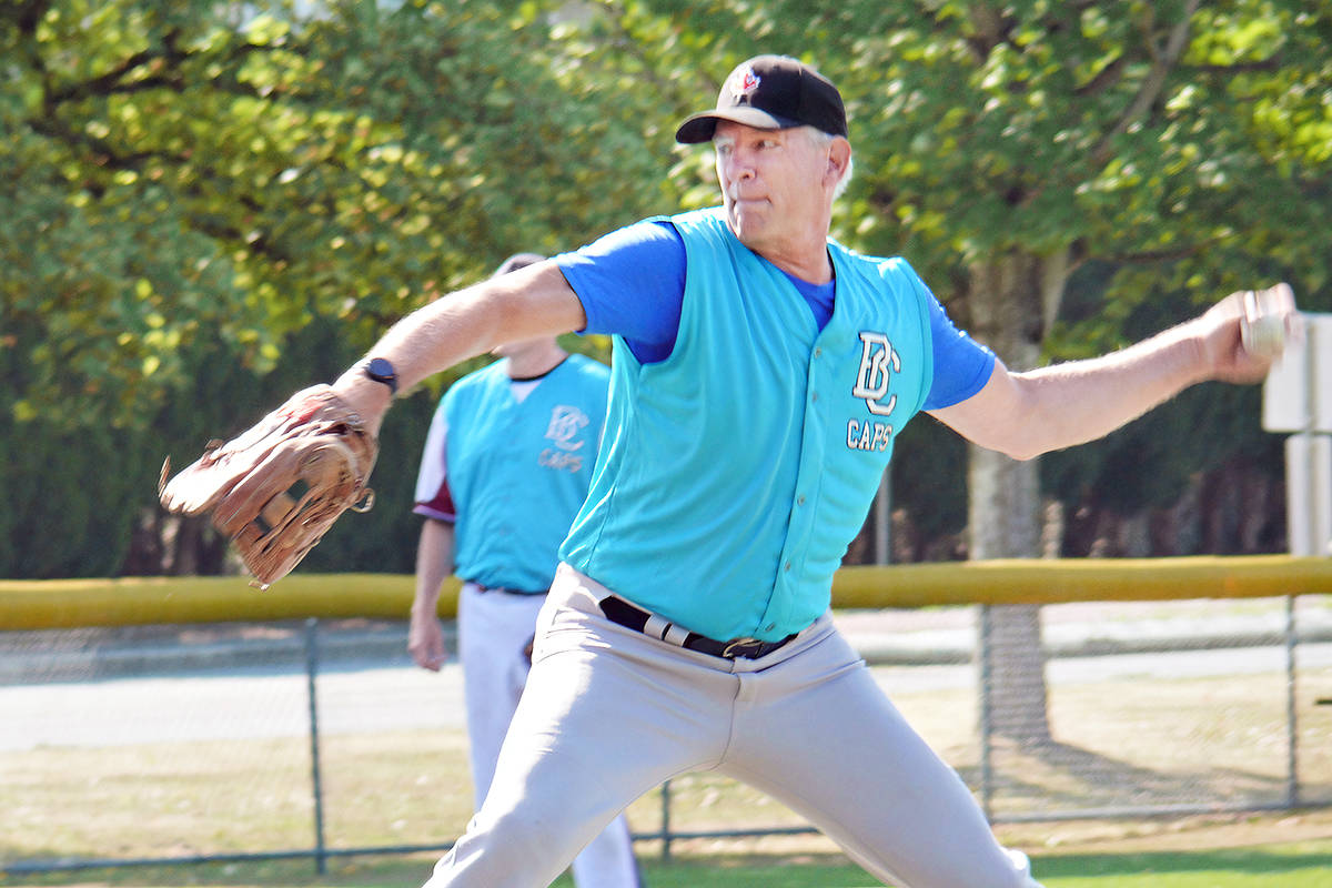 Caps pitcher Wayne Hales brings the heat. A new league for baseball players 60 and older launched at Langley's City Park on Sunday, Aug. 15. It is believed to be the first of its kind in the Lower Mainland.(Dan Ferguson/Langley Advance Times)