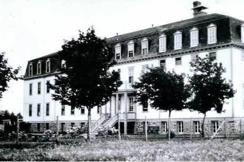An exterior view of the residential school of the Obaltes Sisters in Fort Alexandre is shown in this handout image provided by the archives of the Societe historique de Saint-Boniface. A tally from police across the country shows there are four ongoing criminal investigations and one decade-long probe into complaints involving residential schools. THE CANADIAN PRESS/HO-Archives of the Societe historique de Saint-Boniface *MANDATORY CREDIT*