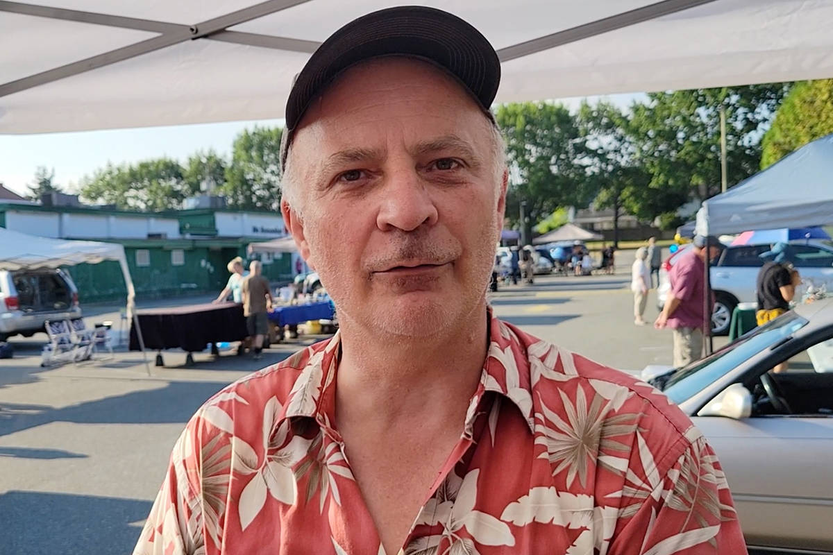 Harley Waterson of Fraser Valley Rock & Gem Club explained the tailgate sale, on Sunday, Aug. 15 in the parking lot of the Aldergrove Legion, was a first for the club. (Dan Ferguson/Langley Advance Times)
