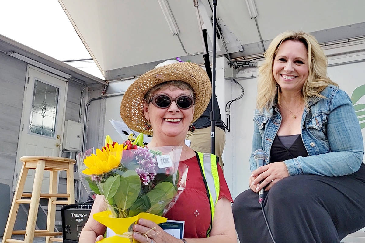 Marie Gold (L) , whose initiative led to the Tastes of Our Town event in Aldergrove on Saturday, Aug. 14, was singled out for recognition by event MC, singer Alyssa Nielsen. (R) (Dan Ferguson/Langley Advance Times)