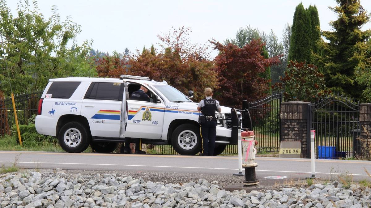 The discovery of a body drew a large police presence in Pitt Meadows on Aug. 15. 2021. (Shane MacKichan)