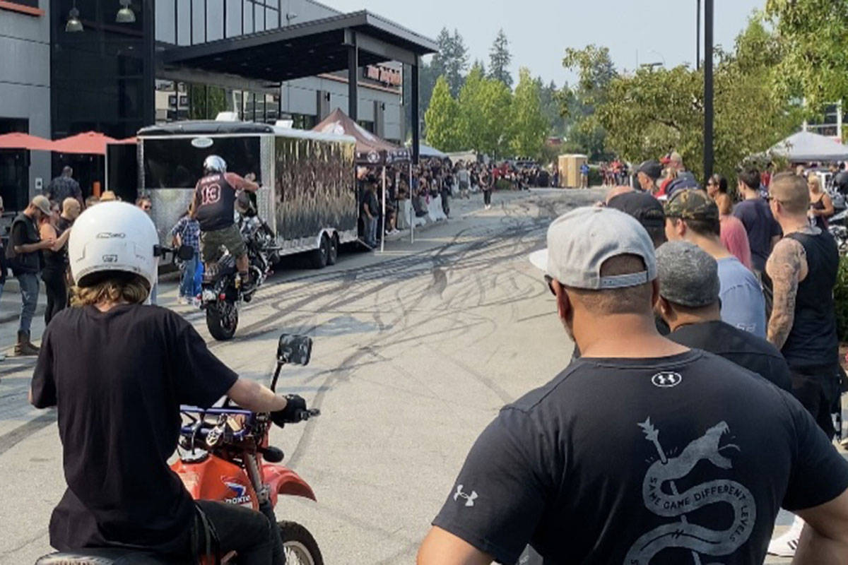 Officers with the Langley RCMP and Combined Forces Special Enforcement Unit (CFSEU) were invited to Barnes Harley-Davidson in Langley for the seventh annual Strong & Free Show and Shine on Saturday, Aug. 14, 2021. (Lindsey Houghton/Special to Langley Advance Times)