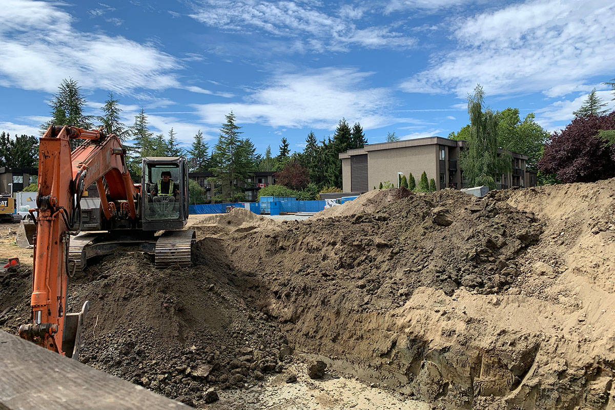 Construction has already begun at 20355 54th Ave. A new eight-storey apartment building with 101 single-bedroom units will replace the Birch, a three-storey, 66-unit apartment building that was consumed by a fire in 2017, the provincial government announced Tuesday, Aug. 17, 2021. (Roxanne Hooper/Langley Advance Times)