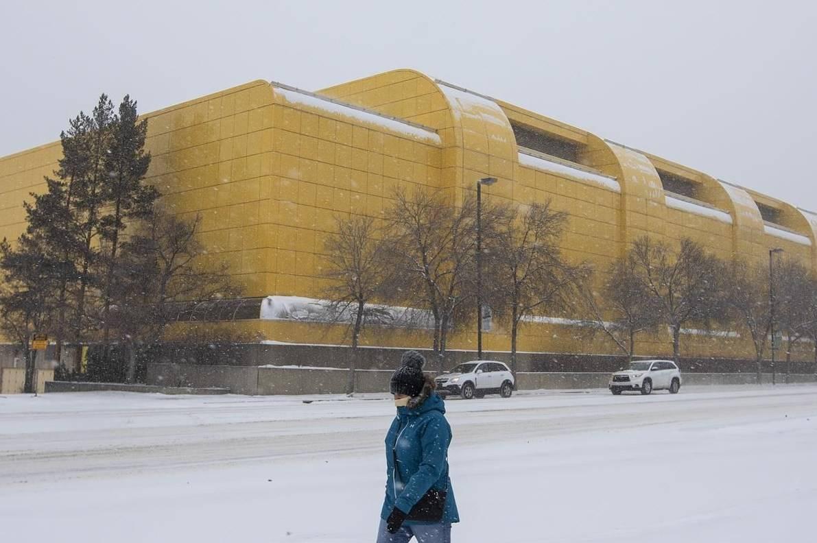 A pedestrian walks past the University of Alberta Butter Dome in Edmonton Alta, on December 17, 2020. THE CANADIAN PRESS/Jason Franson