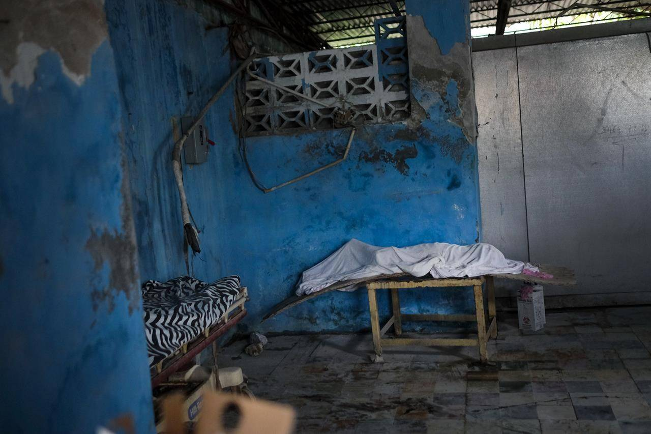 The bodies of two victims lie at the morgue of the Immaculée Conception hospital in Les Cayes, Haiti, Monday, Aug. 16, 2021, two days after a 7.2-magnitude earthquake struck the southwestern part of the country. (AP Photo/Matias Delacroix)