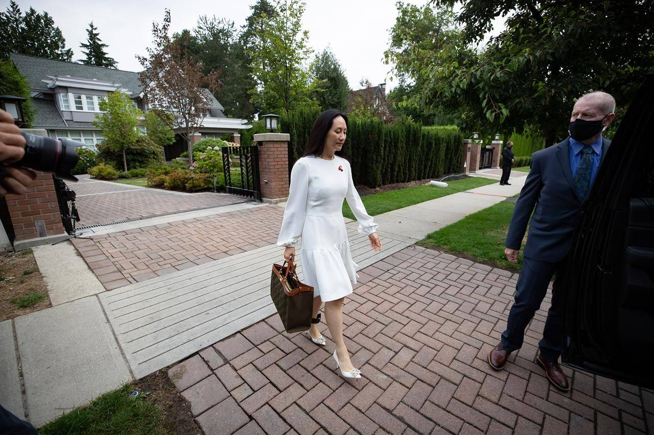 Meng Wanzhou, chief financial officer of Huawei, leaves home to attend her extradition hearing at B.C. Supreme Court, in Vancouver, on Tuesday, August 17, 2021. THE CANADIAN PRESS/Darryl Dyck