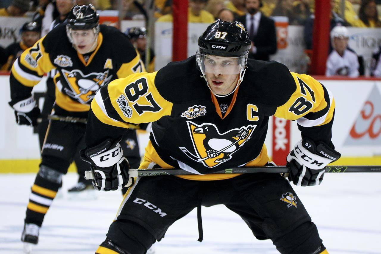 FILE - In this April 12, 2017, file photo, Pittsburgh Penguins' Sidney Crosby (87) and Evgeni Malkin (71) line up for a face-off during the second period in Game one of a first-round NHL hockey playoff series against the Columbus Blue Jackets in Pittsburgh. Jersey advertisements are coming to the NHL. The league will allow teams to put sponsor patches on jerseys beginning with the 2022-23 season after the board of governors unanimously approved the move, according to a person with knowledge of a memo sent this week. The person spoke to The Associated Press on condition of anonymity Tuesday, Aug. 17, 2021, because the league had not announced the decision. (AP Photo/Gene J. Puskar)