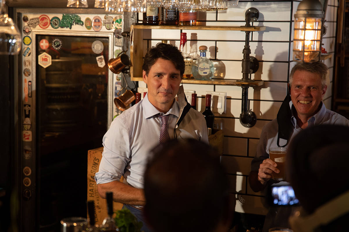 Justin Trudeau and Cloverdale-Langley City hopeful Liberal John Aldag stand behind the bar and serve a few pints at the Hawthorne pub in Cloverdale Aug. 18. Trudeau was in Cloverdale to support Aldag's bid to retake the riding after losing to Tamara Jansen in the 2019 federal election. (Photo: Jason Sveinson)