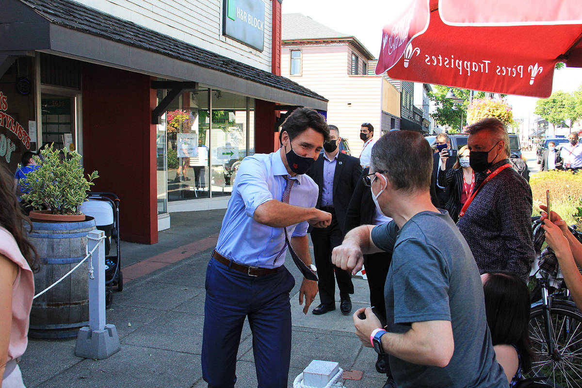 Justin Trudeau makes a campaign stop at the Hawthorne pub in Cloverdale Aug. 18 to support John Aldag's bid to retake the riding of Cloverdale-Langley City after losing to Tamara Jansen in the 2019 federal election. Trudeau and Aldag hopped behind the bar to pour a few glasses of beer. (Photo: Malin Jordan)