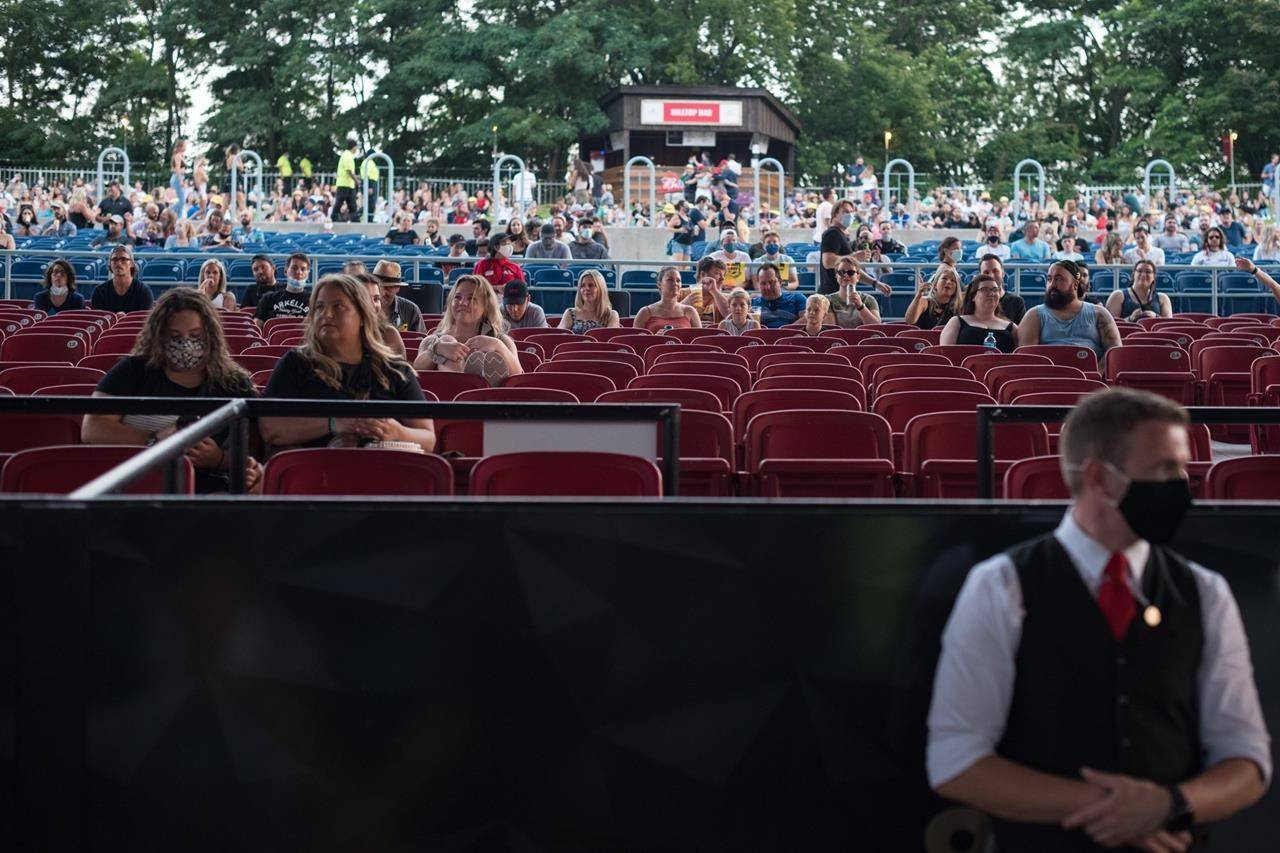 People social distance as Haviah Mighty opens up for the Arkells concert at the Budwieser Stage in Toronto on August 13, 2021. THE CANADIAN PRESS/Tijana Martin