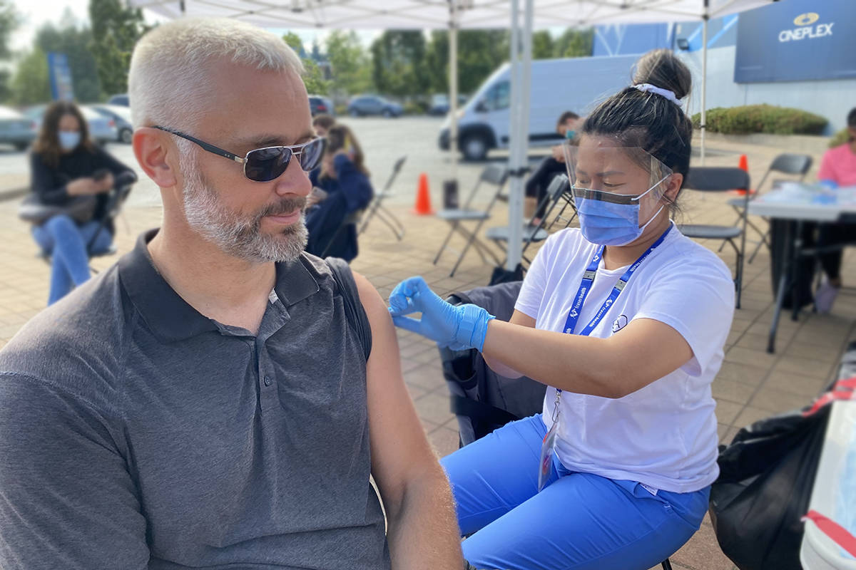 Christian Hall had tried to get his jab in Pitt Meadows where he lives but zipped over to Langley while the clinic was open at Colossus Cineplex. (Joti Grewal/Langley Advance Times)