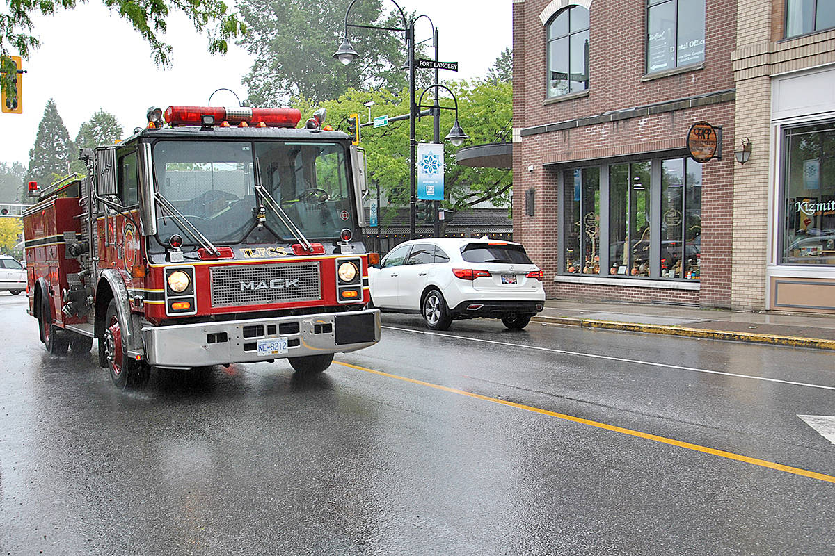 A Township fire truck brought up the rear at the vehicle parade held in Fort Langley on Victoria Day. In addition to going to emergency calls, local first responders support the community at events and with fundraising. (Langley Advance Times files)