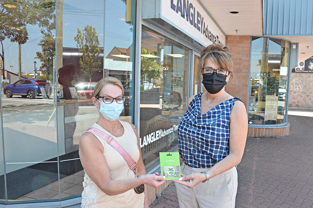 Belinda Jaster (left) submitted a list of her favourite local businesses, and in doing so, won the draw for a $250 Save-On-Foods gift card presented by Advance Times publisher Lisa Farquharson. (Heather Colpitts/Langley Advance Times)