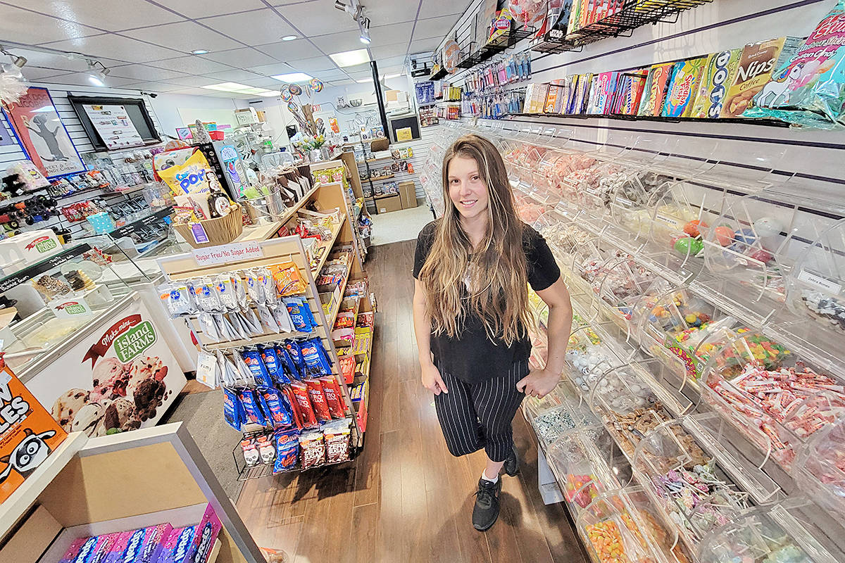 """Kirstie Bouchard held down the fort Tuesday at her family's downtown Langley City business. Sticky's Candy is one of several Langley businesses re-crowned the community's """"favourite"""" in the Langley Advance Times Readers' Choice competition. (Dan Ferguson/Langley Advance Times)"""