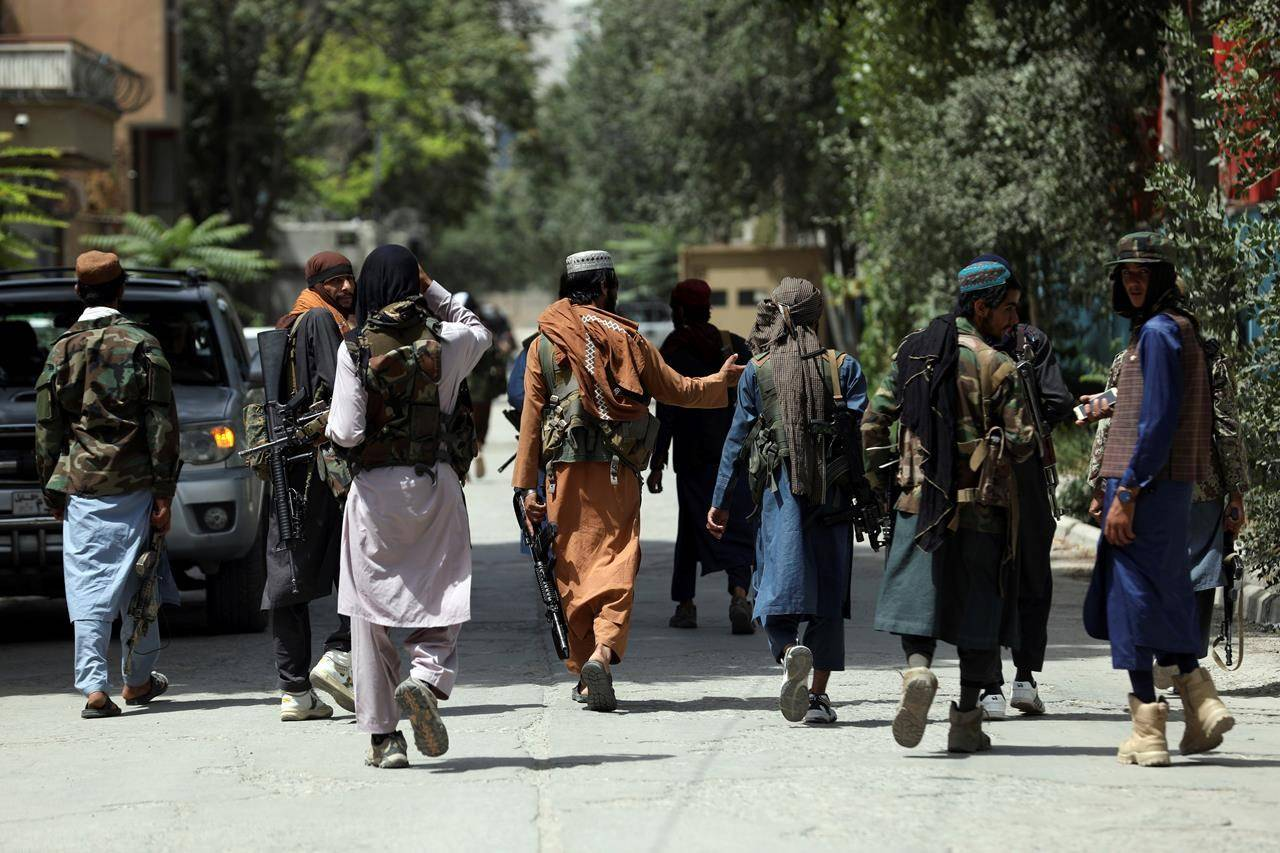 Taliban fighters patrol in the Wazir Akbar Khan neighborhood in the city of Kabul, Afghanistan, Wednesday, Aug. 18, 2021. THE CANADIAN PRESS/AP, Rahmat Gul