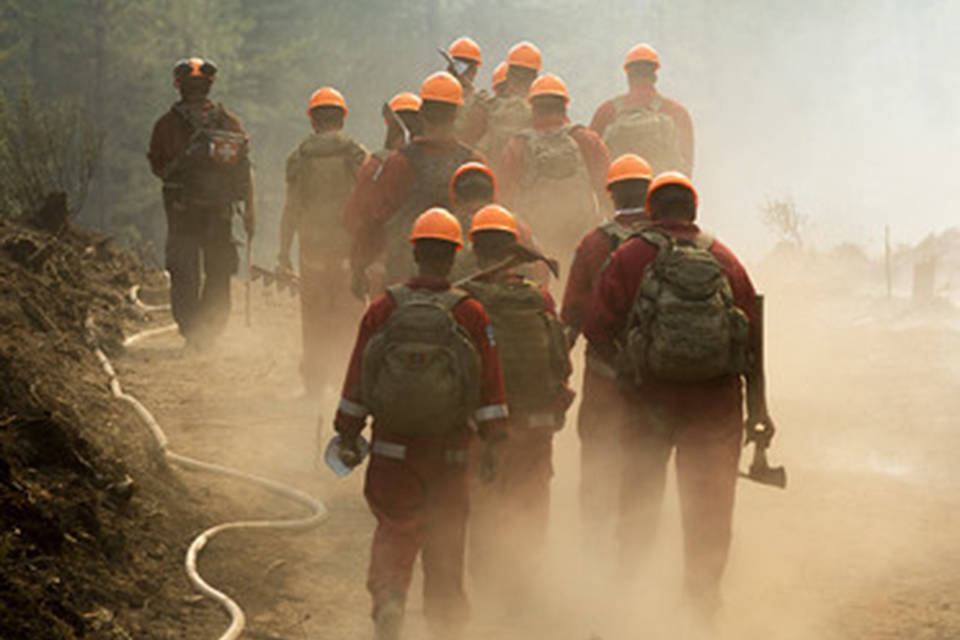 Brentt Call, a firefighters with Utah Taskforce One, walks through a burned over area of the Bootleg Fire east of Klamath Falls as crews work to stop the largest wildfire in the United States so far this season. The Princess Patricia's Canadian Light Infantry celebrated the regiment's 107th birthday fighting the Thomas Creek fire on Aug. 10. (BC Wildfire)