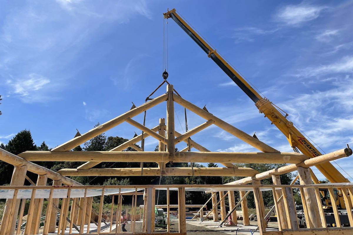 Four cedar trusses are raised onto the Tsawout First Nation's new bighouse in the first week of August. A 2009 fire destroyed the former cultural space. (Courtesy of Dave Watson/Tsawout First Nation)