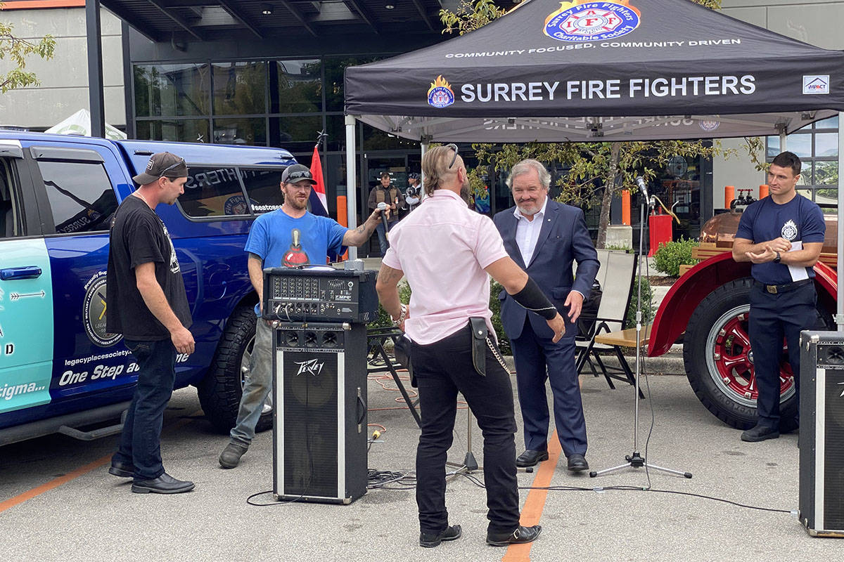 Terrance Kosikar, founder of Camp My Way, a residential wilderness program, thanked former provincial minister of social development and poverty reduction Shane Simpson during the 2021 Ride to Recovery, which made a pit stop at Barnes Harley Davidson in Langley on Aug. 19, 2021. The event was an effort to raise awareness about PTSD. (Joti Grewal/Langley Advance Times)