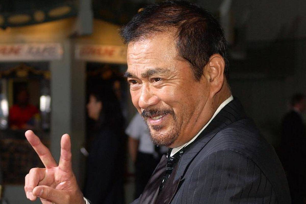 """In this Sept. 29, 2003, file photo, Japanese actor Sonny Chiba arrives for the premiere of the film """"Kill Bill: Volume 1"""" at the Grauman's Chinese Theatre in the Hollywood section of Los Angeles. Chiba, known in Japan as Shinichi Chiba, who wowed the world with his martial arts skills, acting in more than 100 films, including """"Kill Bill,"""" has died late Thursday, Aug. 19, 2021. He was 82. (AP Photo/Kevork Djansezian, File)"""